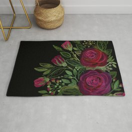 A bouquet of roses on a black background . Rug