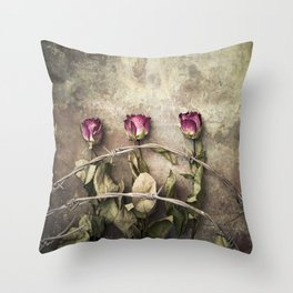 Three dried roses and barbed wire Throw Pillow