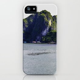 Small Floating Village at the Base of One of the Towering Limestone Mountains in Halong Bay, Vietnam iPhone Case