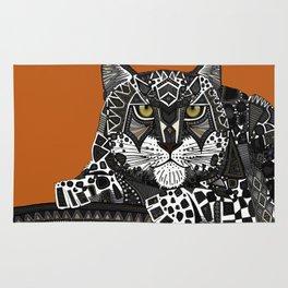 snow leopard orange Rug