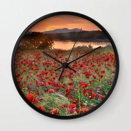 Poppies at the lake at sunset Wall Clock