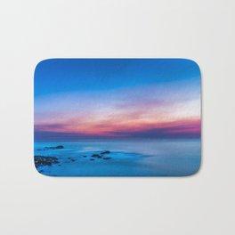 Sunset long exposure over the ocean Bath Mat
