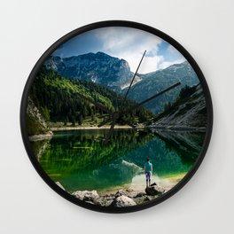 Person at mountain lake Wall Clock