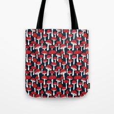 Red mushrooms field on navy blue Tote Bag