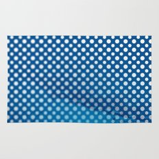 White polka dots and snorkel blue background with blur Rug