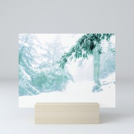 Emerald forest in blizzard and snow Mini Art Print