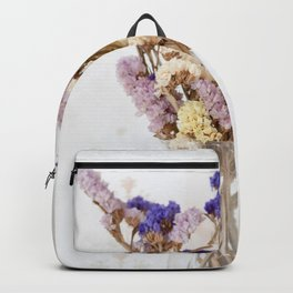Dried flower in glass vase Backpack