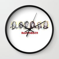iron maiden Wall Clocks featuring Iron Maiden by Nicola Girello
