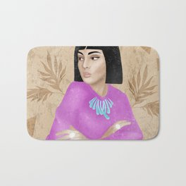 Female universe. Beautiful young woman with a Cleopatra haircut. wearing a pink blouse. Artistic composition. Geometric shapes, leaves, distressed texture. Bath Mat