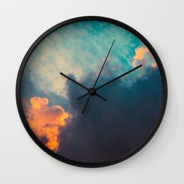 Clouds illuminated and rising sun Wall Clock