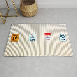 Signs on a corrugated metal wall Rug