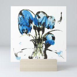 Music Clear and Blue: an elegant design of beautiful bellflowers in a glass vase Mini Art Print