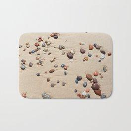 Wet sand and stones on beach Bath Mat