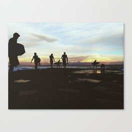Silhouetted Surfers  Canvas Print