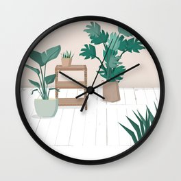 A house with plants is a home Wall Clock