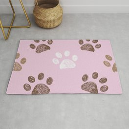 Brown paw print pink background Rug