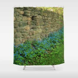 Blue Flowers along a Stone Wall Shower Curtain