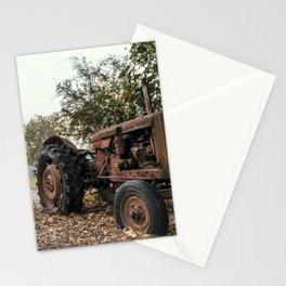 Old tractor on a pebble beach by a river Stationery Cards