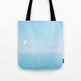 Bird Flying over the Ocean in Kauai Tote Bag