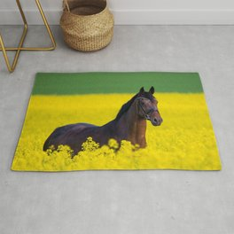 Mare in a field of rapeseed blossoms Rug