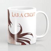 megan lara Mugs featuring Lara Croft by Natalie Lucht