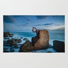 sunrise at the beach, san Sebastian donostia sculpture Rug