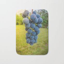 Bunch of grapes over green blurred background Bath Mat