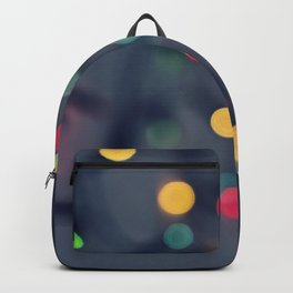 Blurred background with multicolored lights of garland Backpack