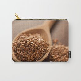 Brown flax seeds heap on wooden spoon Carry-All Pouch