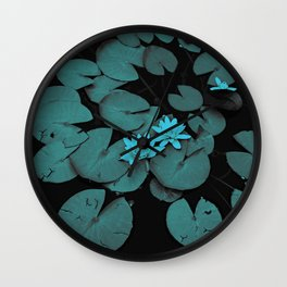 Lily pad in blue nocturne Wall Clock