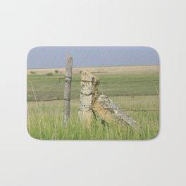 Kansas Limestone Fence Post with grass and blue sky Bath Mat