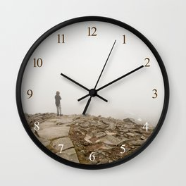 Person standing in fog on peak Wall Clock