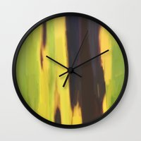 banana leaf Wall Clocks featuring Burnt Banana Leaf by Robert Morris