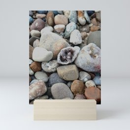Geode on the rocky beach Mini Art Print