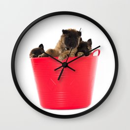 Three puppies in red laundry basket Wall Clock