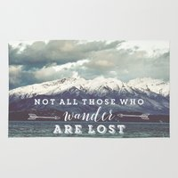 not all those who wander are lost Area & Throw Rugs featuring Not all those who wander are lost by SmallDeskBigIdeas