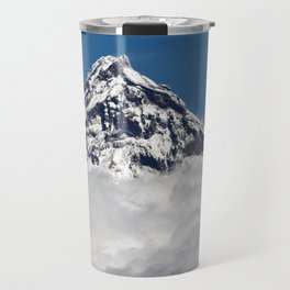Stunning snowy top of rocky volcanoes cones above clouds. Beautiful mountain landscape of Kamchatka Travel Mug
