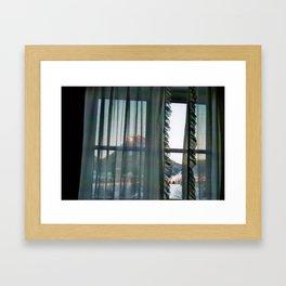 the window. Framed Art Print