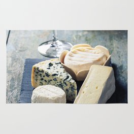 Various types of cheese and white wine Rug