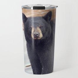 Young black bear near water Travel Mug