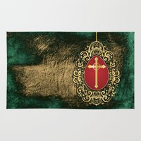 pagan Area & Throw Rugs featuring Beautiful red egg with gold cross on a moody green and gold texture by Wendy Townrow