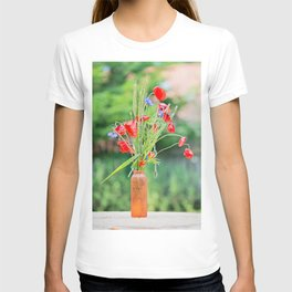 Bunch of of red poppies, cornflowers and ears of barley, wheat and rye on the table. T-shirt