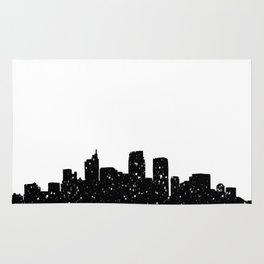 Panorama city in lights or snow Rug