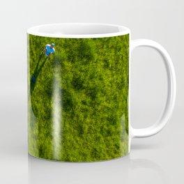 vertical drone shot of pilot in green grass Coffee Mug