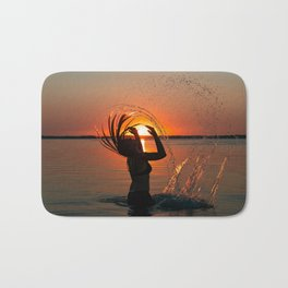 Water and sunset in the backlight Bath Mat