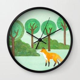 fox in green woods Wall Clock