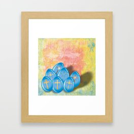 Blue eggs and crosses on pastel textured background Framed Art Print