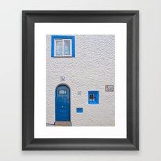 Blue door in Sitges Framed Art Print