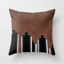 Still Life with dark bottles on a brown background Throw Pillow