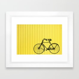 Vintage bike on yellow Framed Art Print